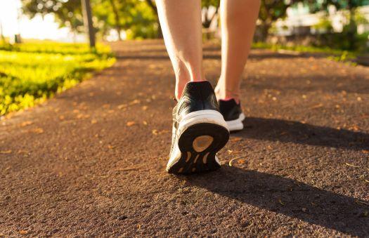 1538172046-woman-walking-on-a-path-royalty-free-image-503818820-1538171480.jpg